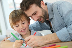 Father and son drawing together. Daddy with little boy making drawings at home Stock Image