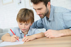Father and son drawing together. Daddy with little boy making drawings at home Stock Images