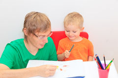 Father and son drawing together Royalty Free Stock Images