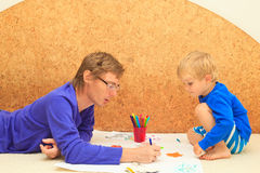 Father and son drawing together Royalty Free Stock Photo