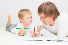 Father and son drawing together Stock Photography