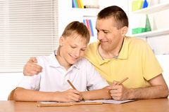 Father and son drawing. Together with pencils Royalty Free Stock Images