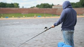 Father and son are fishing on background of river stock video