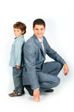 Father with a son, dressed in a suit Royalty Free Stock Photo