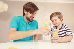 Father and son drink lemonade Royalty Free Stock Photo
