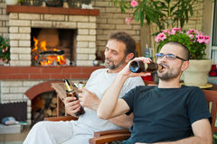 Father and son drinking beer Royalty Free Stock Image
