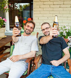 Father and son drinking beer Royalty Free Stock Images