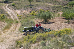 Father And Son Driving Tractor On Field Stock Images