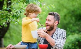 Free Father Son Eat Food And Have Fun. Feeding Baby. Menu For Children. Family Enjoy Homemade Meal. Food Habits. Little Boy Royalty Free Stock Photo - 176457685