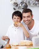 Father and son eating a toast Royalty Free Stock Photos