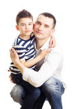 Father and son embrace Stock Photos