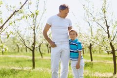 Father and son embrace in the garden in the spring of summer. stock photo