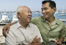 Father and son embracing at port Royalty Free Stock Photography