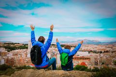 Father and son enjoy travel together, looking at panoramic city view. Family vacation stock images