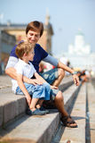 Father and son enjoying day out in city center Royalty Free Stock Images