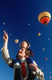 Father and son enjoying the Hot Air Ballon Festiva Stock Photo