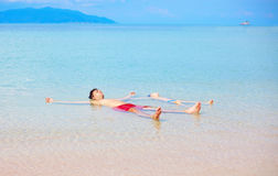 Father and son enjoying life, relaxing in water edge. Smiling father and son enjoying life, relaxing in water edge Stock Photography