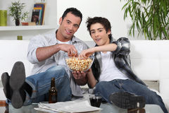 Father and son enjoying a movie Royalty Free Stock Photo