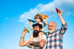 Father and son enjoying outdoor. Father and son playing outdoors. Happy men loving family. Happy grandfather father and stock image