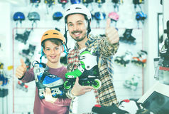Father and son enjoying purchased roller-skates Stock Image