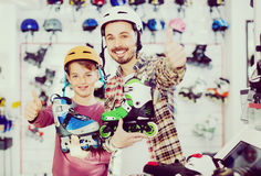 Father and son enjoying purchased roller-skates Royalty Free Stock Photography