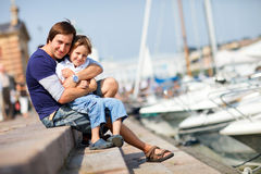 Father and son enjoying summer day. In city stock photo