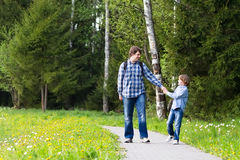 Father and son enjoying a walk in the forest Royalty Free Stock Photo