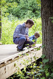 Father and son exploring nature Royalty Free Stock Image