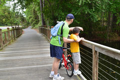 Father and son exploring nature. Father and son on a wooden bridge, exploring nature on the Hilton Head Island, South Carolina, USA Royalty Free Stock Photography