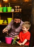 Father and son. Family day. Greenhouse. bearded man and little boy child love nature. happy gardeners with spring. Father and son. Family day. Greenhouse stock photography