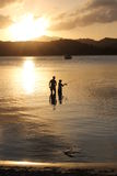 Father and son family fishing at sunset Stock Photos
