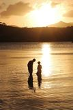 Father and son family fishing at sunset Royalty Free Stock Image