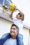 Father And Son Family Playing Basketball Outside Garage Royalty Free Stock Image
