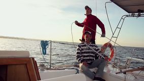 Father and son on a fast-sailing yacht, family vacation, trip. Stock footage stock footage