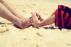 Father and son feet on summer beach Royalty Free Stock Photos