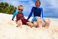 Father and son feet on summer beach. Family relax Stock Images