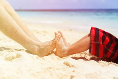 Father and son feet on summer beach. Family relax Royalty Free Stock Photo