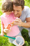 Father And Son In Field With Net And Bug Catcher Stock Images
