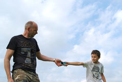 Father and son fighting over a cellphone Royalty Free Stock Images