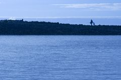 Father and Son Fishing. Father and Son Going Fishing royalty free stock photos
