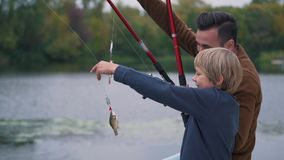 Father with son are fishing