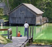 Father and son fishing. Father and son fish together Royalty Free Stock Photos