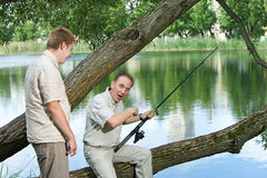 The father with the son on fishing Stock Image
