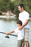 Father and son fishing. Father and son on a fishing trip Royalty Free Stock Photography