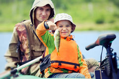 Father and son fishing Stock Images