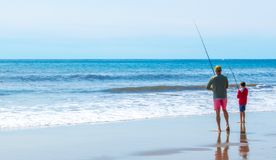 A father and son fishing at the beach. A father and son fishing from the sand at Arroyo Burro Beach in Santa Barbara, California on a sunny day stock photo