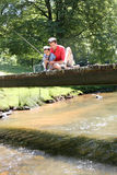 Father and son fishing from bridge Royalty Free Stock Image