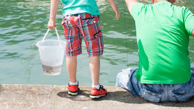 Father and son fishing. Stock Images