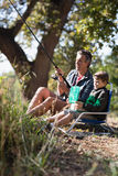 Father and son fishing in forest. On sunny day royalty free stock photo