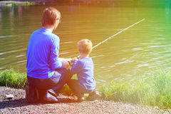 Father and son fishing on the lake Stock Photo